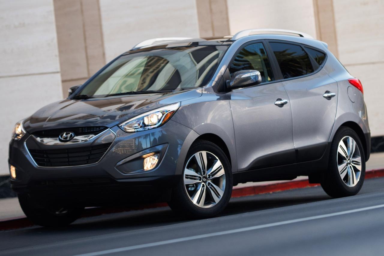 2014 Hyundai Tucson SE Slide 0