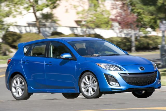 2011 Mazda Mazda3 I TOURING 4dr Car Slide 0