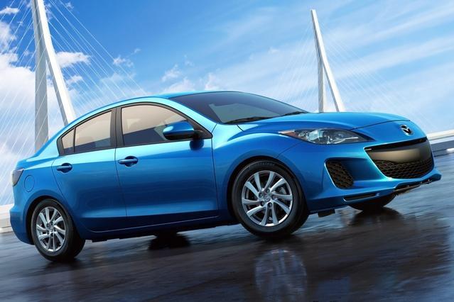 2013 Mazda Mazda3 I TOURING 4dr Car Slide 0