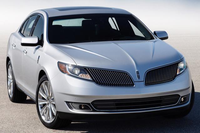 2013 Lincoln MKS BASE 4dr Car Slide 0