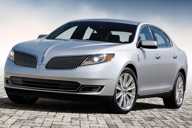 2015 Lincoln MKS BASE 4dr Car Slide 0