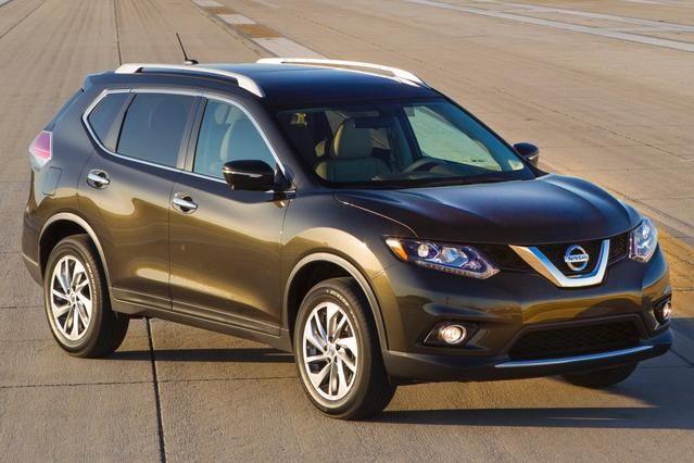 2015 Nissan Rogue S Sport Utility Slide 0