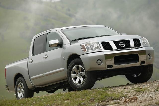 2007 Nissan Titan LE Extended Cab Pickup Slide 0