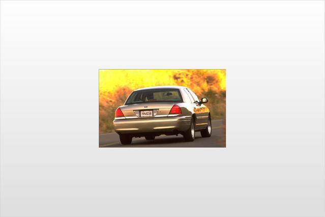 1999 Ford Crown Victoria LX 4dr Car Slide 0