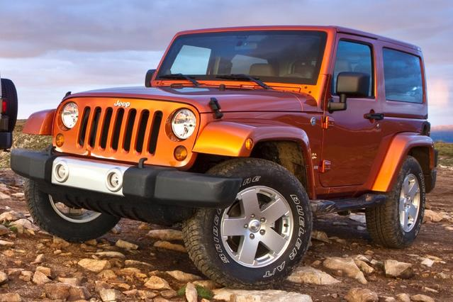 2012 Jeep Wrangler Unlimited SAHARA SUV Slide 0