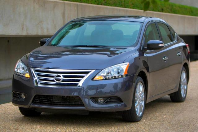 2015 Nissan Sentra  4dr Car Slide 0