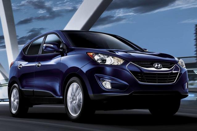 2013 Hyundai Tucson LIMITED Sport Utility Slide 0