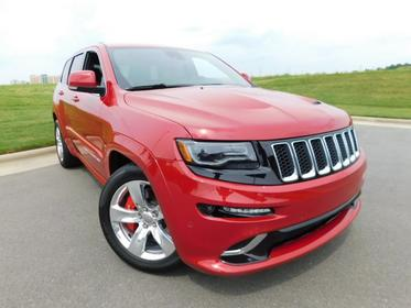 2015 Jeep Grand Cherokee SRT Sport Utility Slide 0