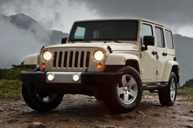 2012 Jeep Wrangler UNLIMITED SPORT Slide 0