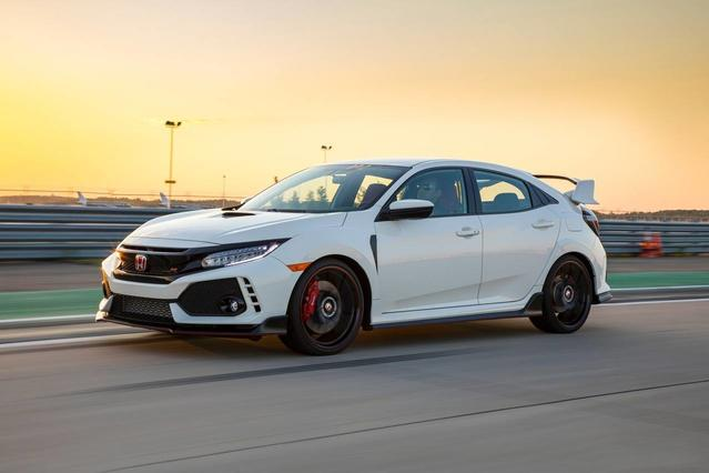 2018 Honda Civic SPORT TOURING Hatchback Slide 0
