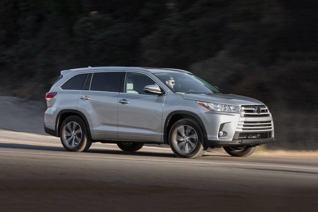 2019 Toyota Highlander LE Sport Utility Slide 0