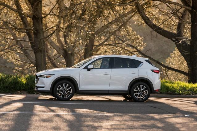 2019 Mazda Mazda CX-5 GRAND TOURING Sport Utility Slide 0