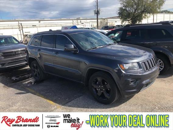 2015 Jeep Grand Cherokee ALTITUDE Sport Utility Slide 0