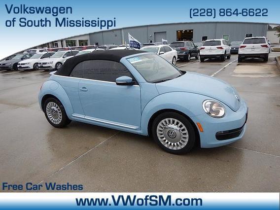2014 Volkswagen Beetle Convertible 1.8T Convertible Slide 0