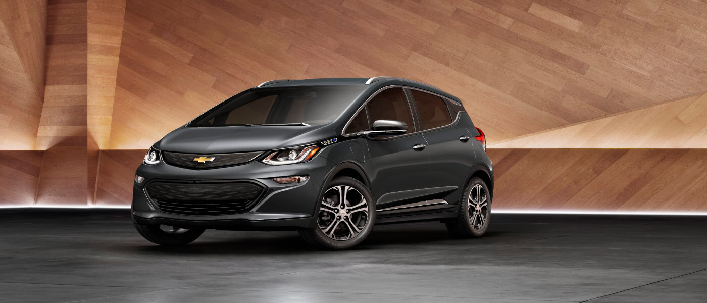 2019 Chevy Bolt exterior parked by wood panel wall