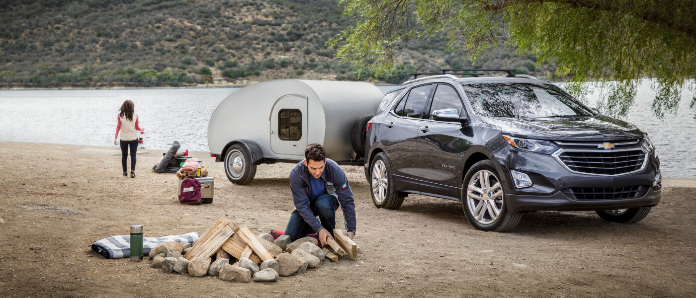 2020 Chevy Equinox exterior family with camper by lake