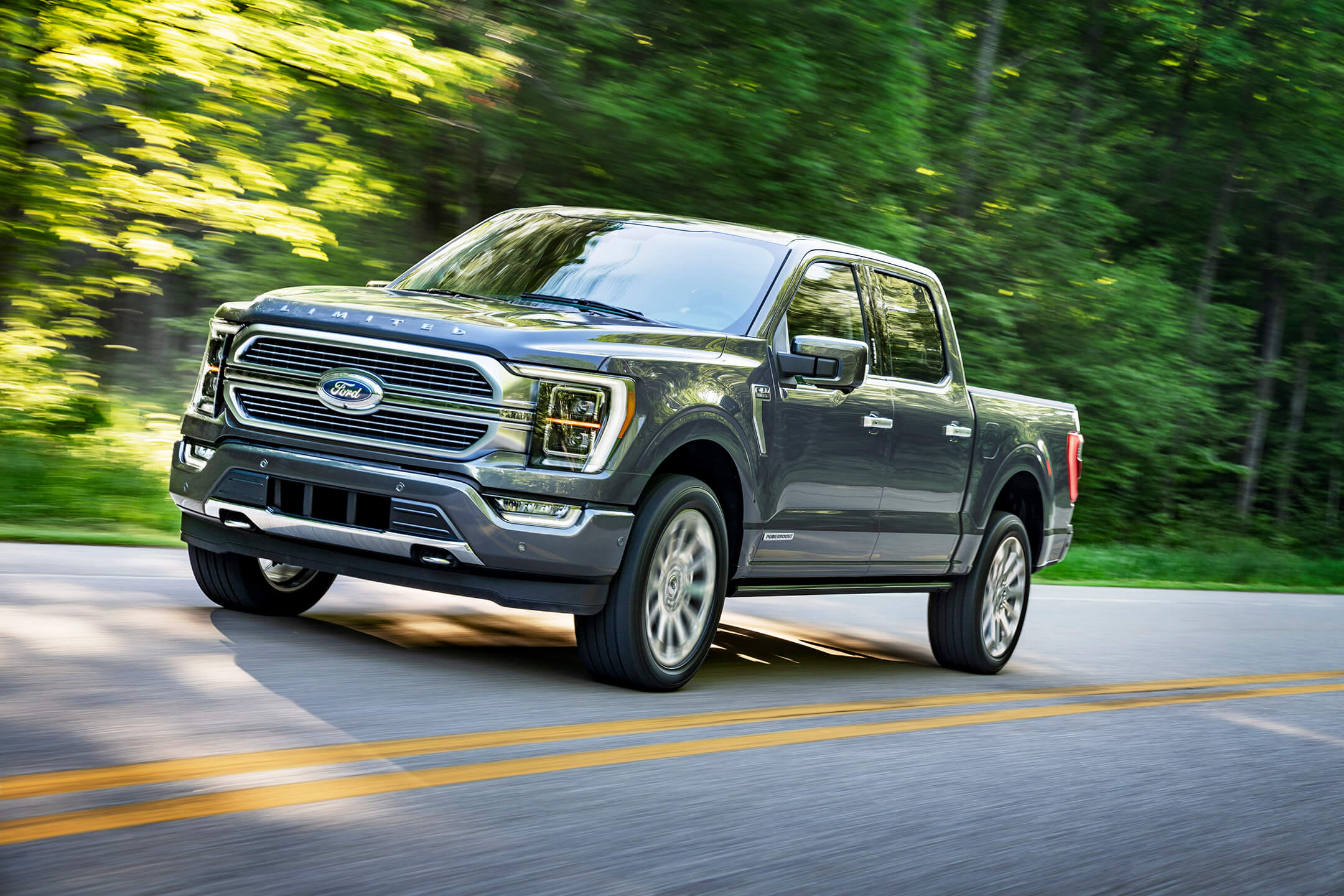 ford f150 driving on a road
