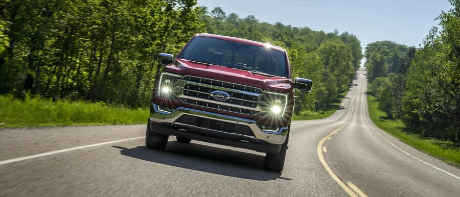 Ford F150 driving down the road