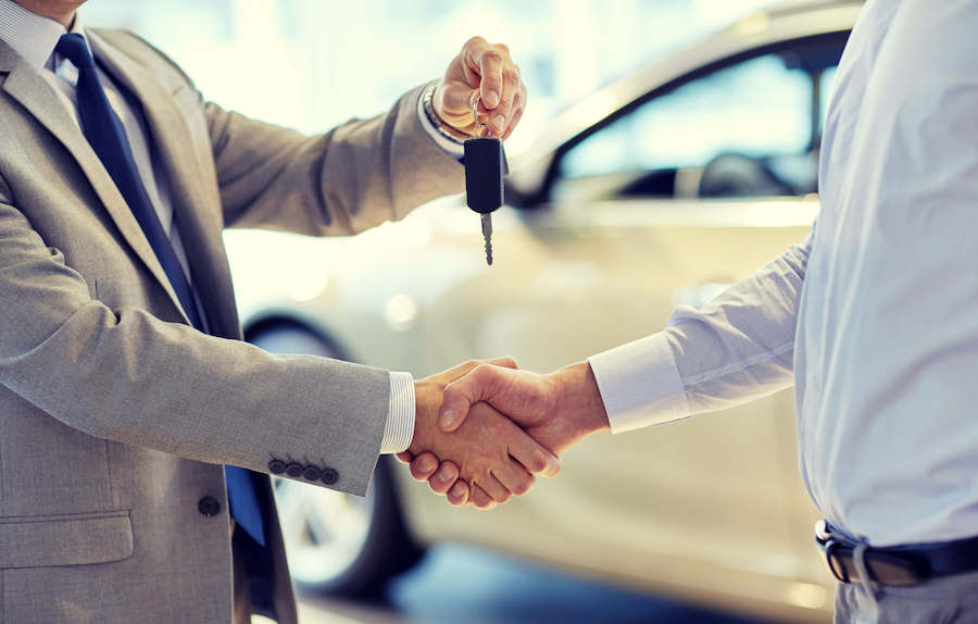 Shaking hands before handing keys to customer