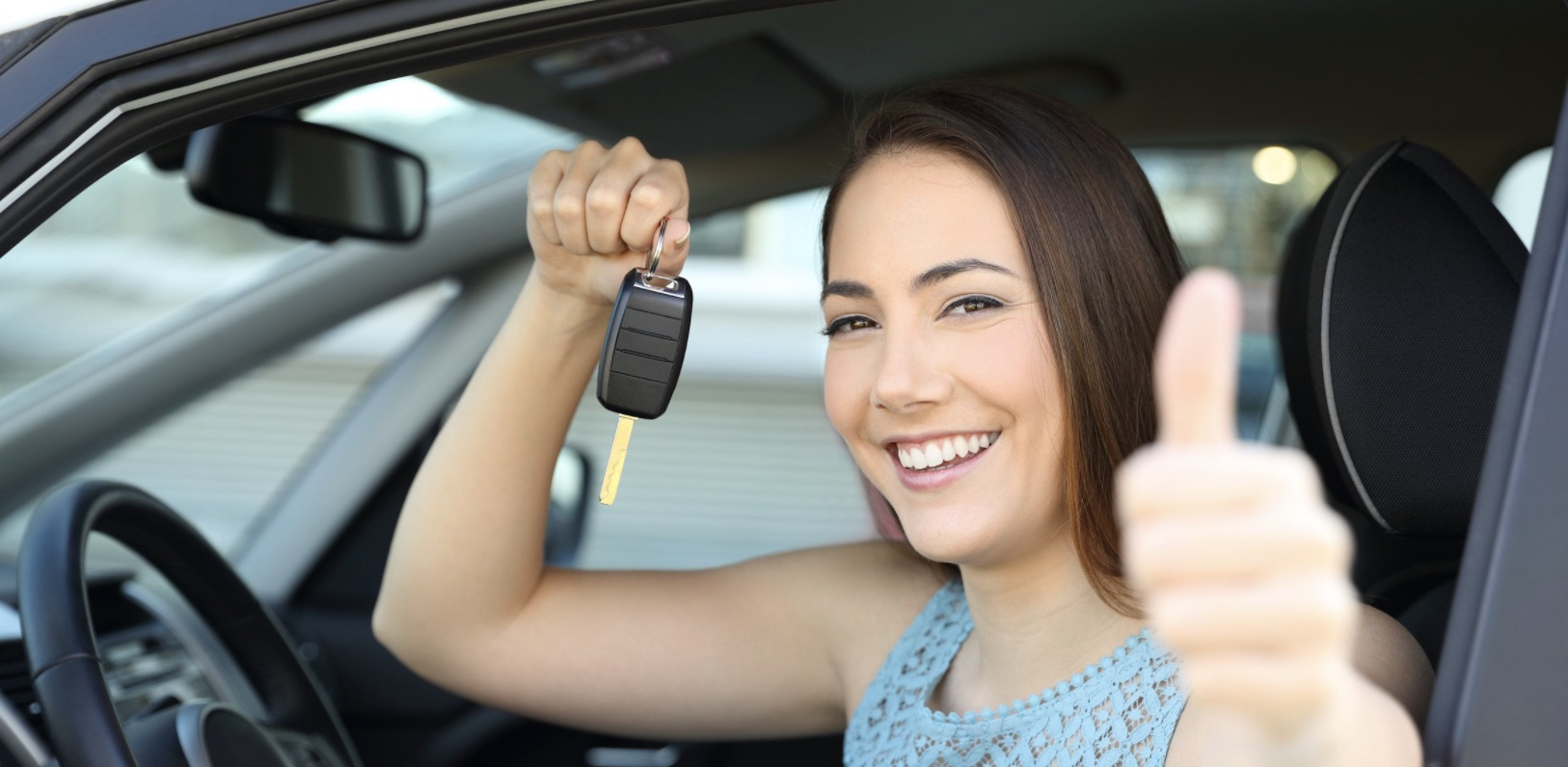 Young professional woman showing her excitement about receiving a car loan from Sansone Jr's NJ Auto Lending.