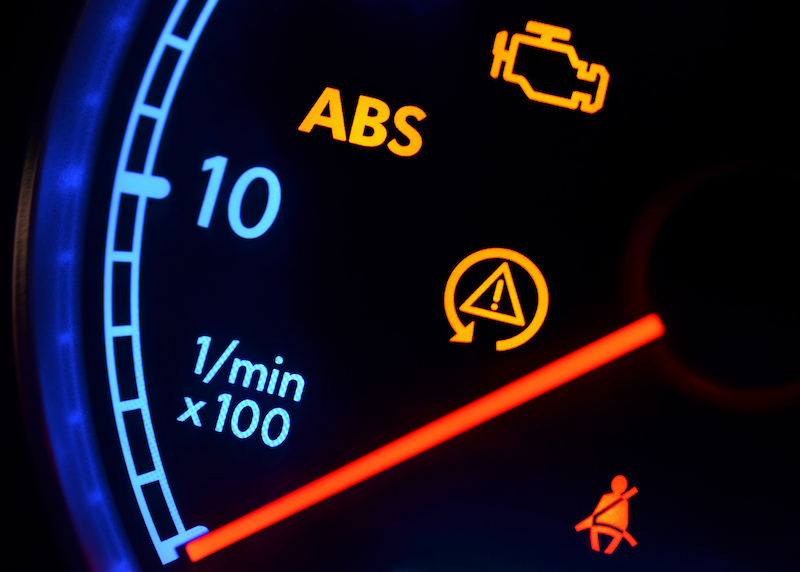 Close up of dashboard with multiple warning lights on