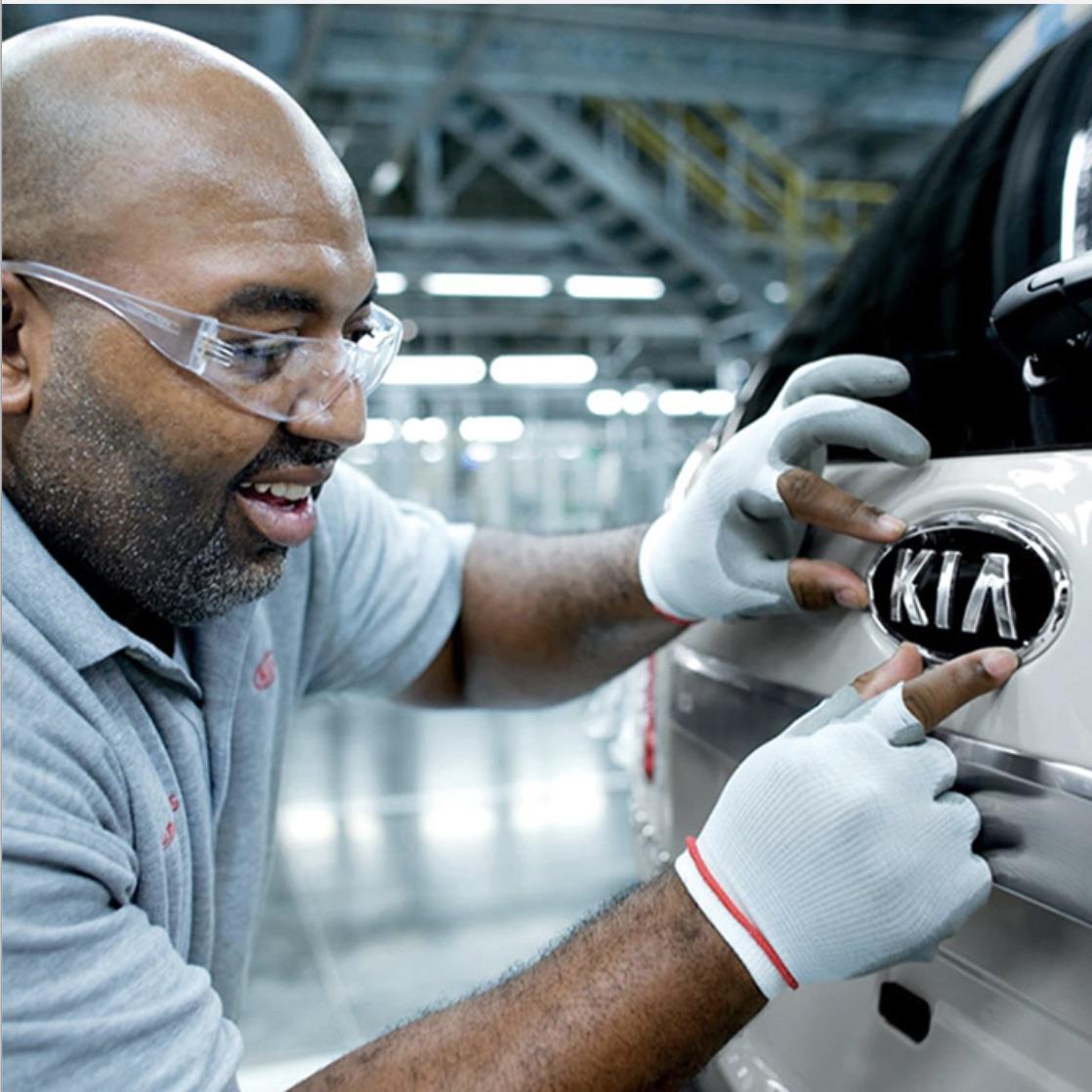 Man taking care of a Kia vehicle as part of Kia's warranty program at Gateway Kia of Denville.