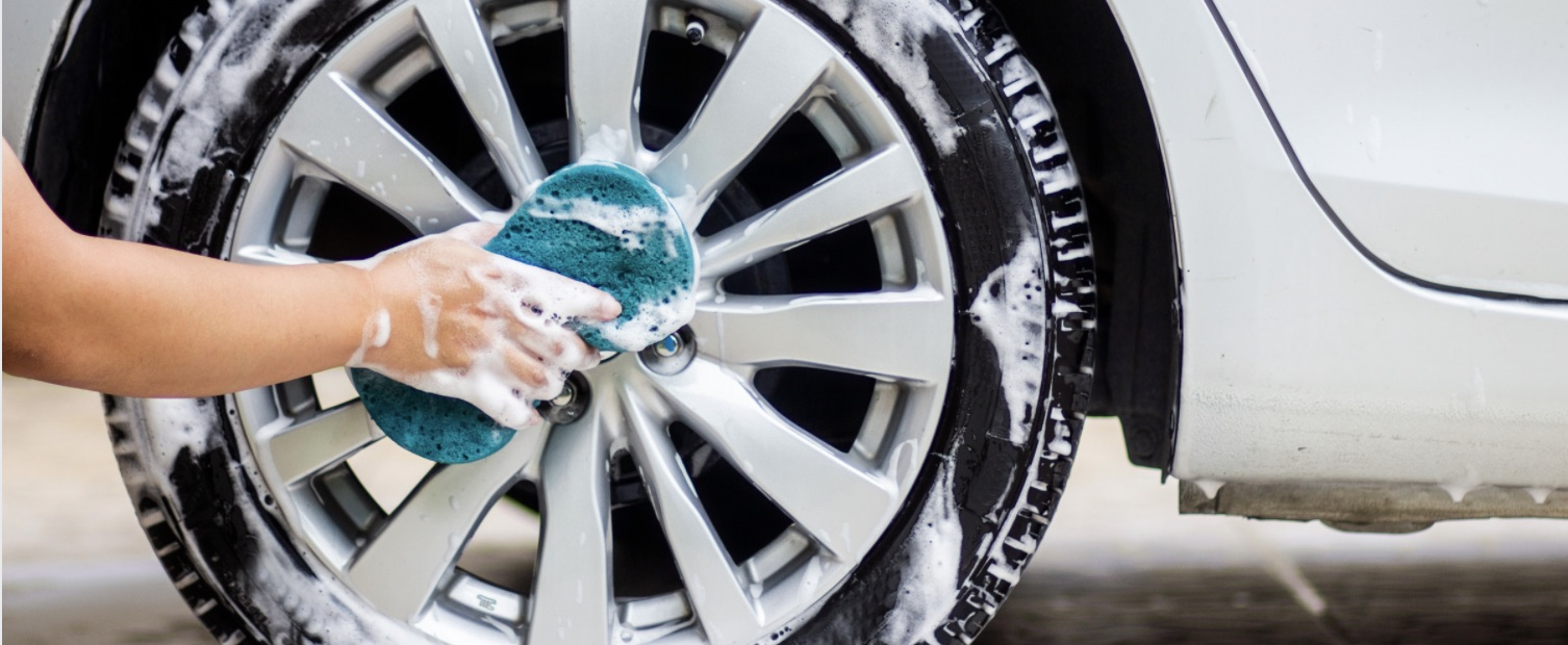 Cleaning the tires on your car during summer.