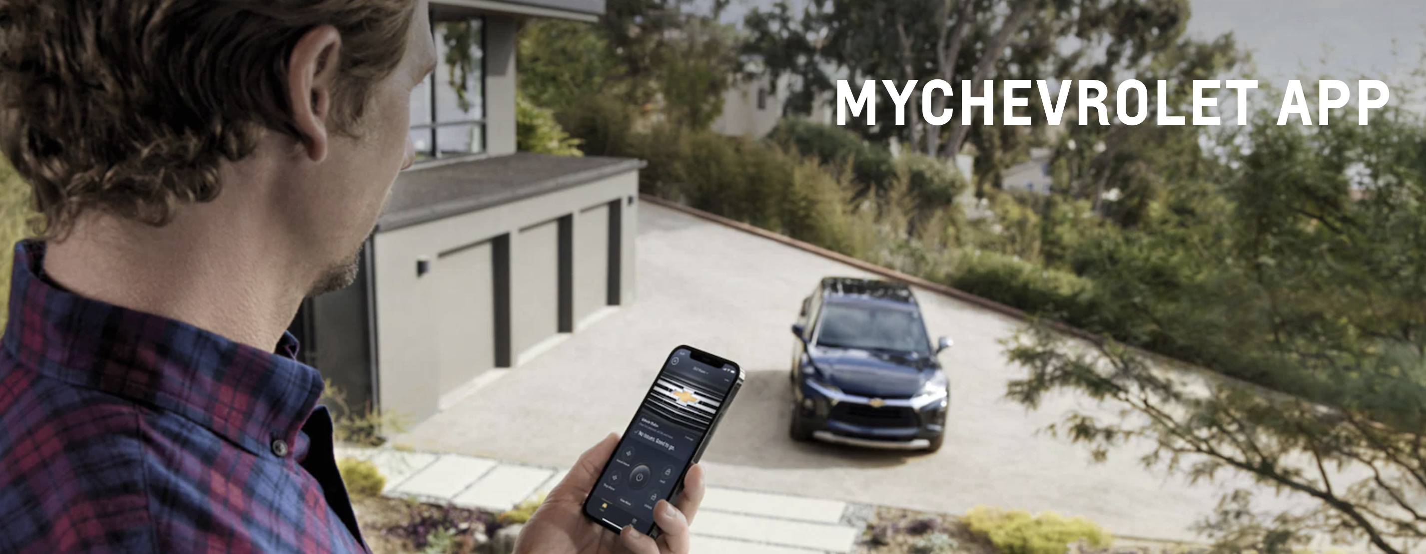 A man using the MyChevrolet app on his Chevrolet vehicle