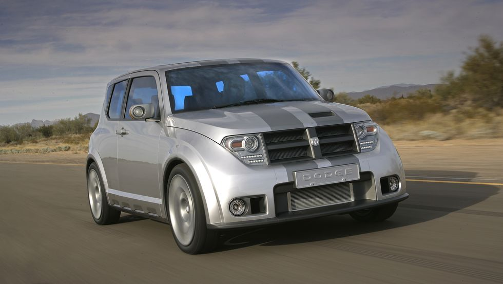 Image of a Grey Dodge Hybrid Concept driving through a desert