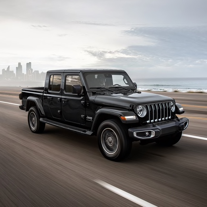 New black 2021 Jeep Gladiator driving down a road on a sunny day