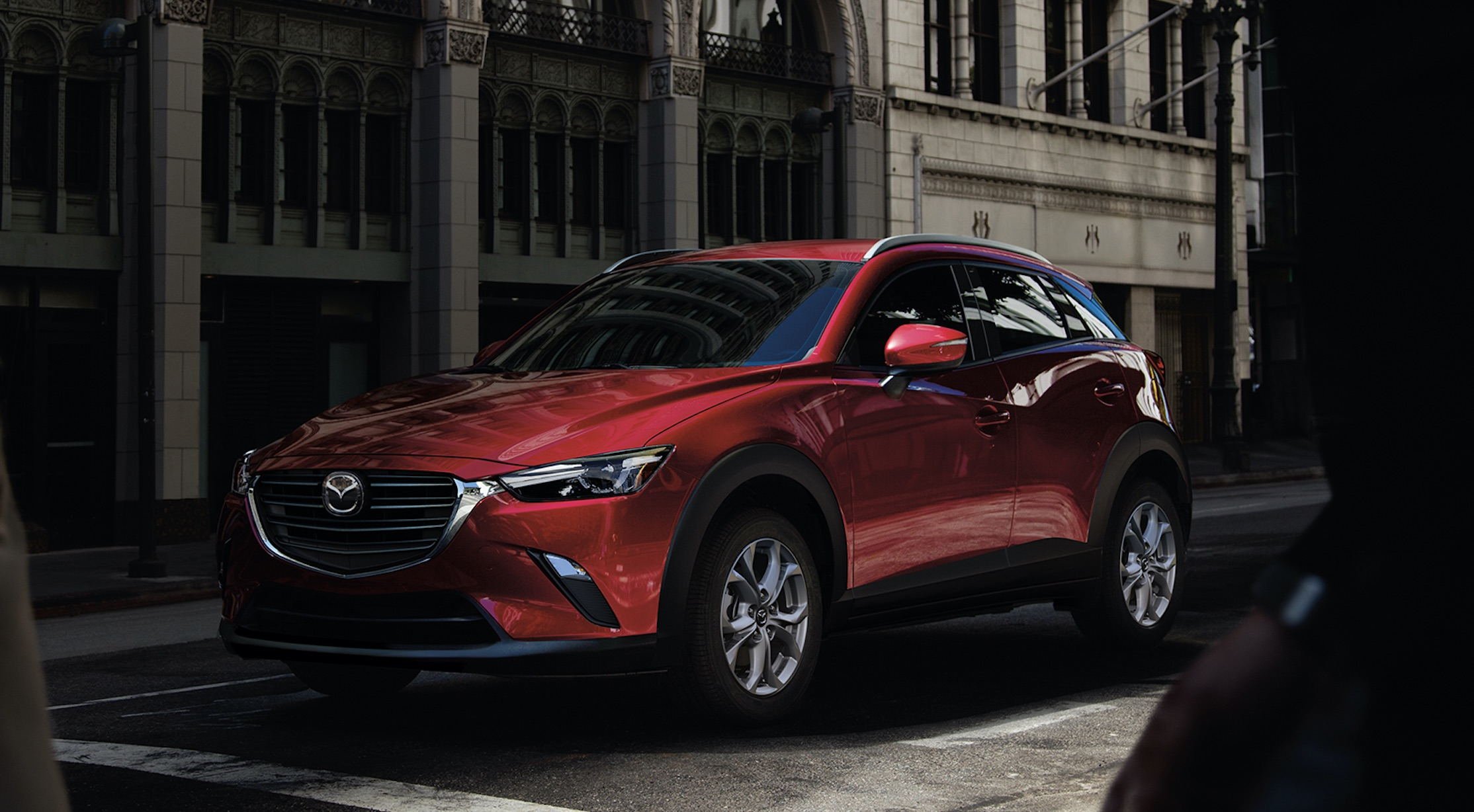 Red 2022 Mazda CX-3 parked on a city street