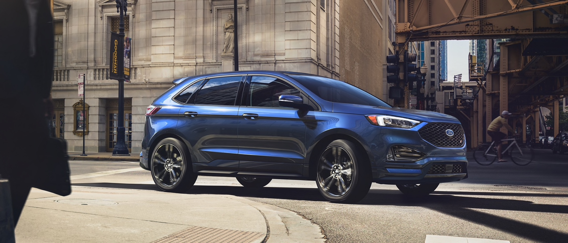 Blue 2021 Ford Edge parked on a city street