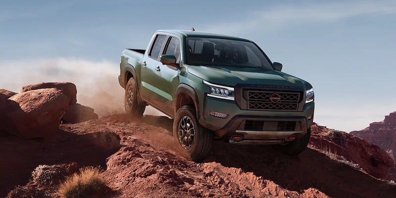 A green 2022 Nissan Frontier off-roading