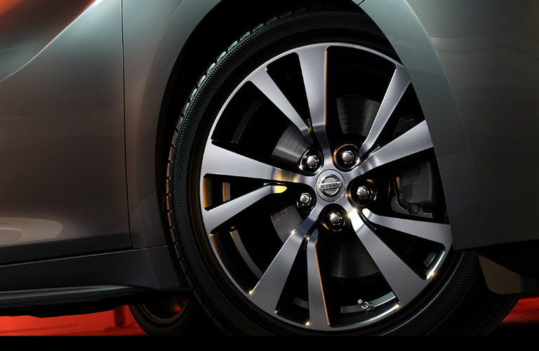 A close-up image of a Nissan tire on a vehicle