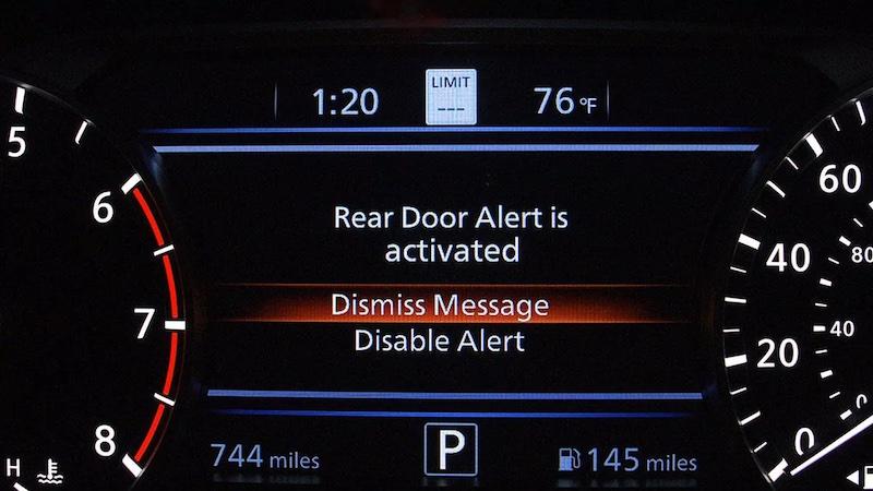 The Nissan Rear Door Alert activating on the vehicle dashboard
